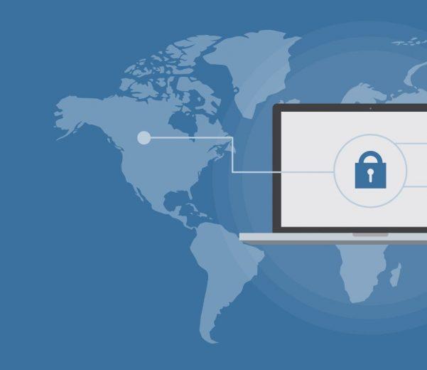 laptop with padlock visual overlaid on world map