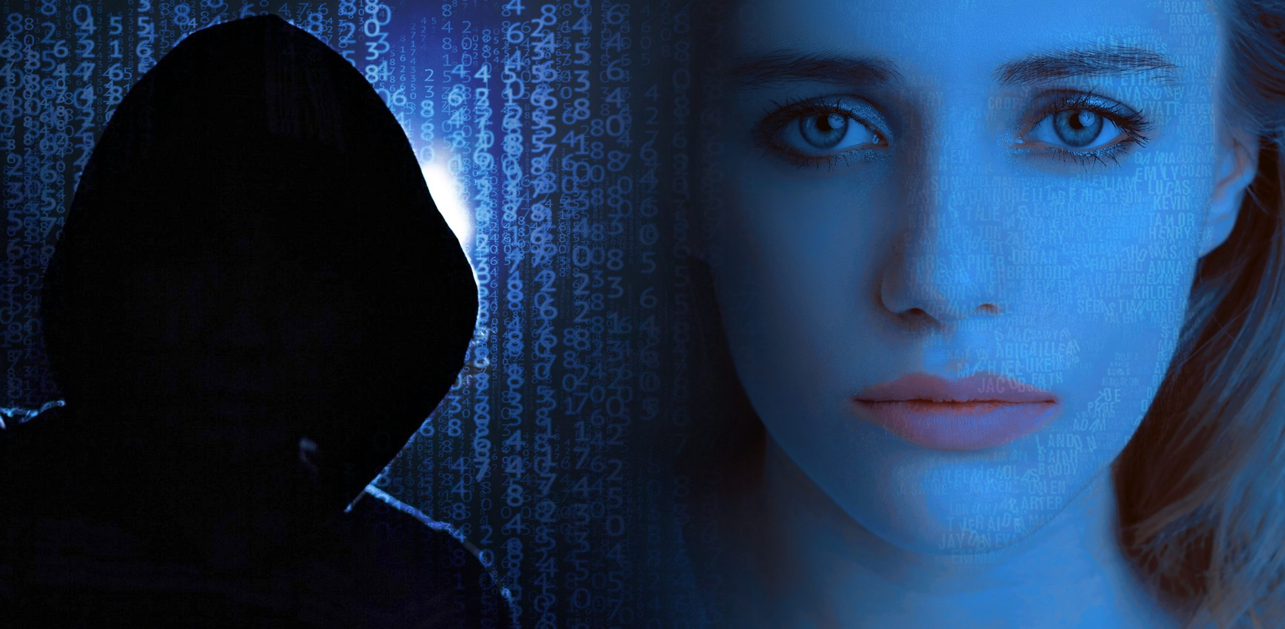 hooded hacker next to female victim